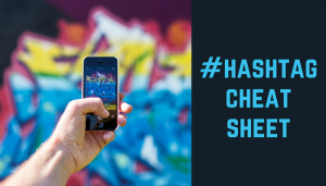 "Hand holding cell phone with header ""Hashtag Cheat Sheet"""